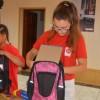 Wolontariusze Caritasu pakowali plecaki